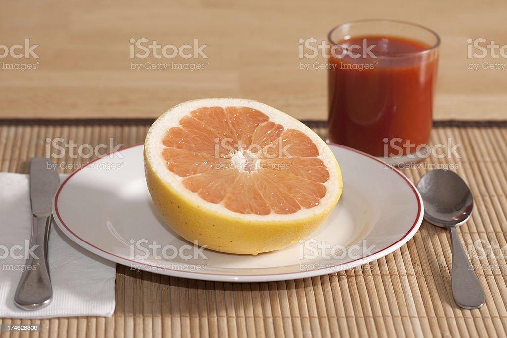Half Graperfruit and Vegetable Juice Breakfast royalty-free stock photo