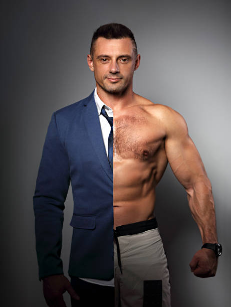 Half happy success business man in style blue suit and half of strong athlete with biceps on grey background. Concept photo of motivation in sport and health in one person stock photo