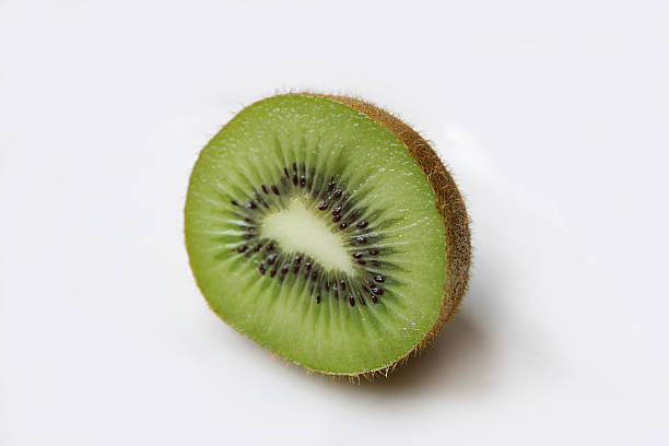 Half kiwi with white background stock photo