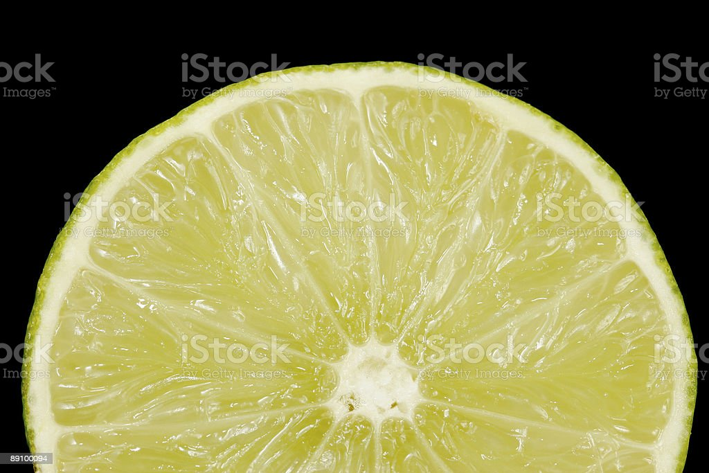 Half Lime on Black Background royalty-free stock photo