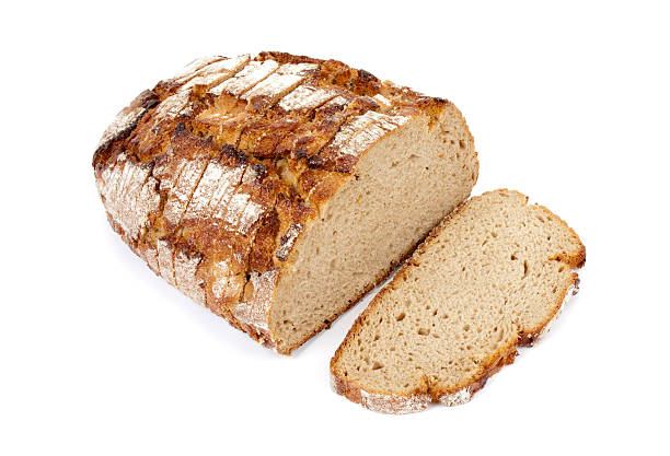 half loaf of bread Sliced crusty whole wheat bread on white background round loaf stock pictures, royalty-free photos & images
