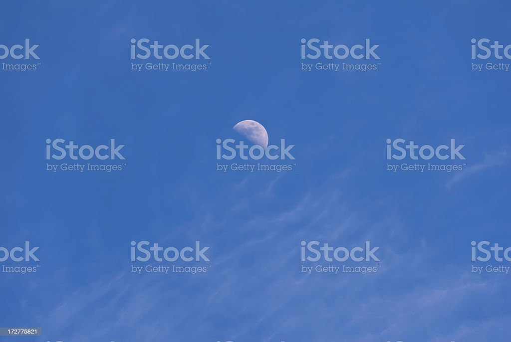 Half Moon and Wispy Clouds royalty-free stock photo
