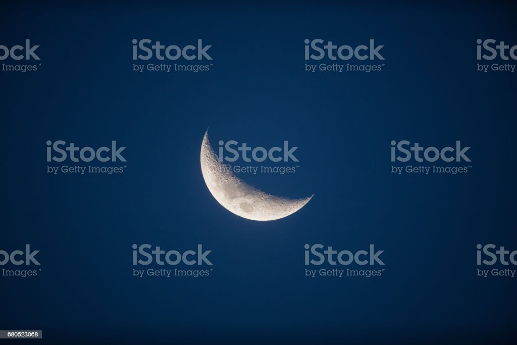 Half Moon on a dark - blue background. Photographed through a long focal telescope. My astronomy work. stock photo