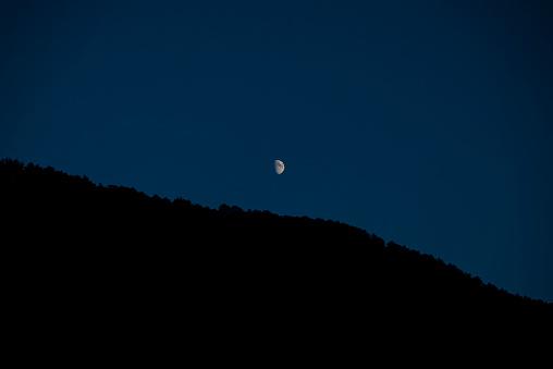 Half moon on black sky