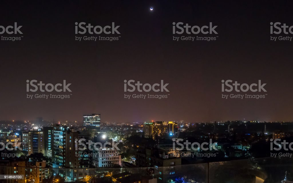 Half Moon Over Downtowm Bangalore Night Lights stock photo