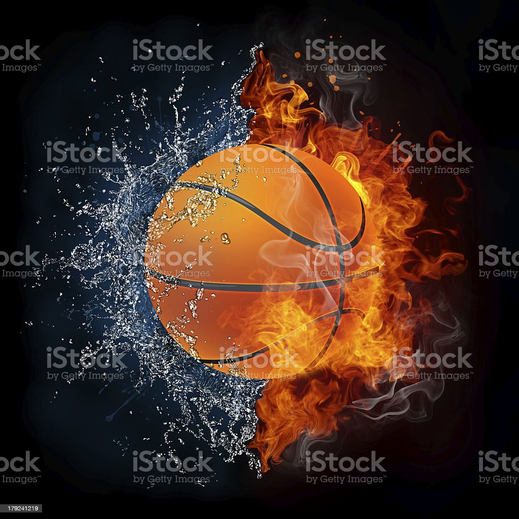 A half of a basketball with water splash and another in fire stock photo