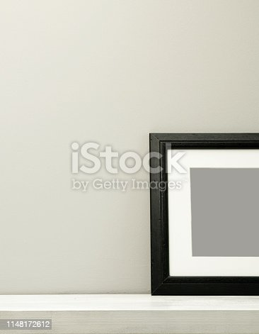 532332971 istock photo Half of a blank frame on a gray background with clipping path 1148172612