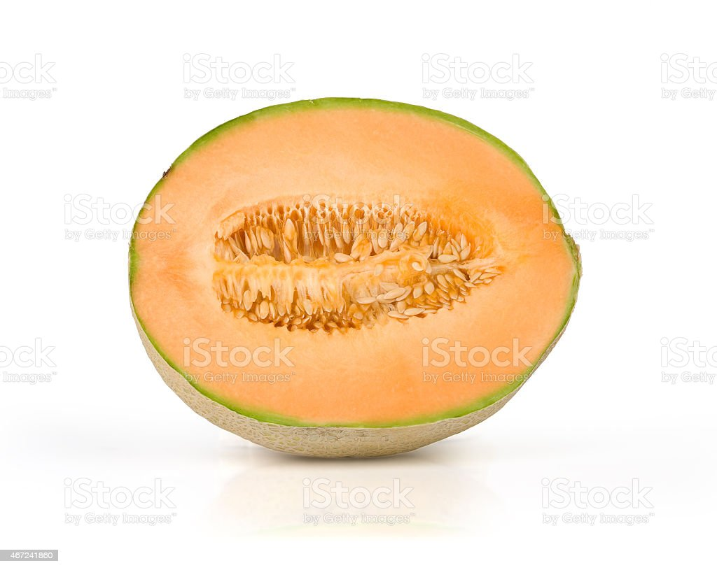 Half of a cantaloupe on a white background stock photo