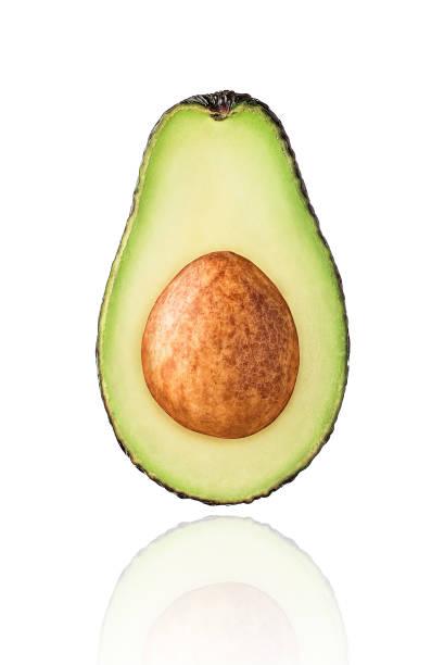 Half of Avocado fruit, slice, isolated on white background stock photo