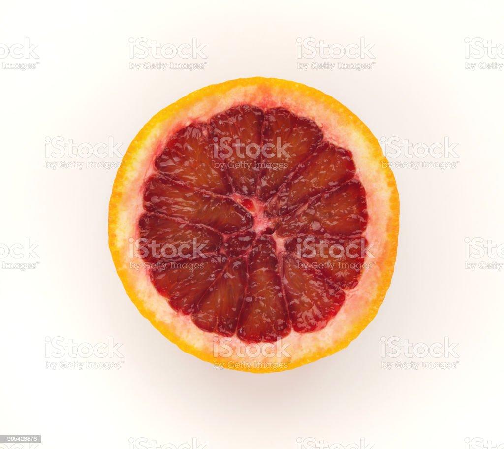 Half of bloody orange isolated on white background zbiór zdjęć royalty-free