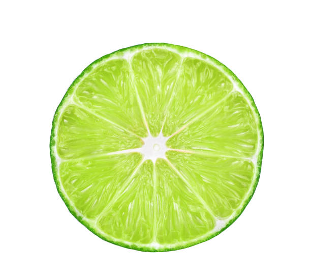 half of fresh lime isolated on white background half of fresh lime isolated on white background lime stock pictures, royalty-free photos & images