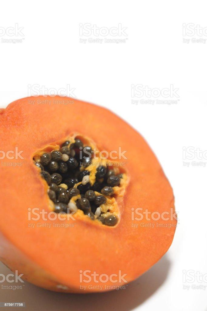 Half of freshly yellow orange papaya on white background stock photo