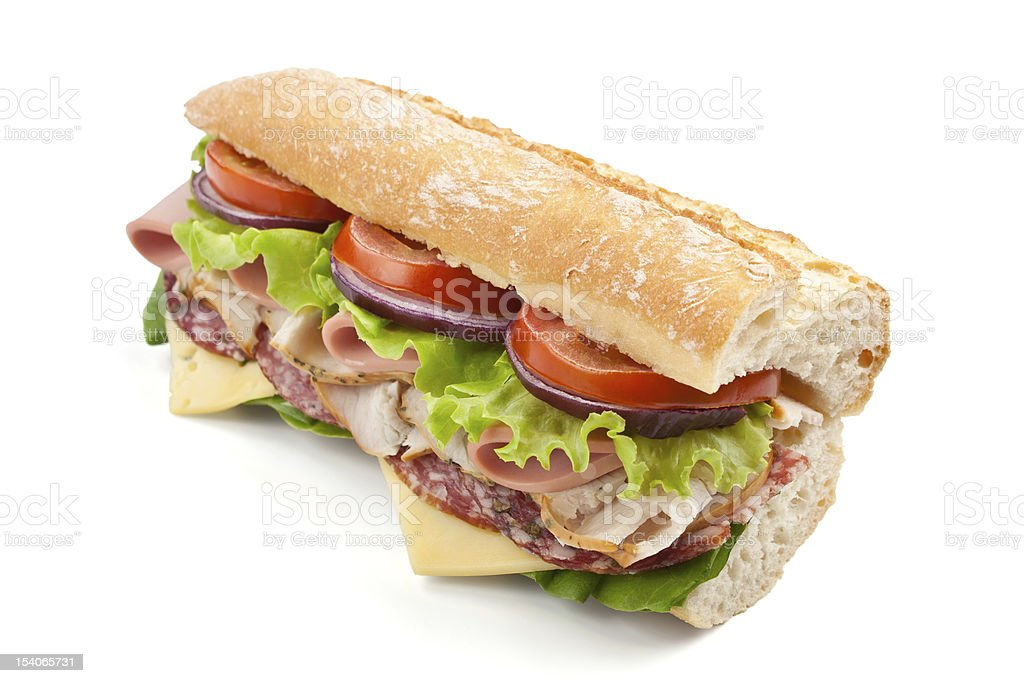 half of long baguette sandwich with meat, vegetables and cheese stock photo