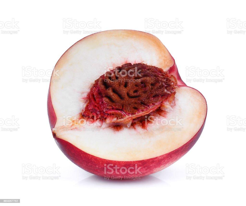 half of nectarine fruit isolated on whitie background stock photo