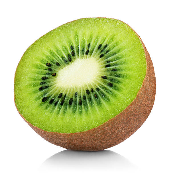 half of ripe kiwi fruit isolated on white - 奇異果 個照片及圖片檔