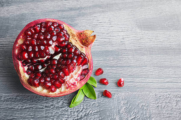 Half of s pomegranate fruit with seeds stock photo