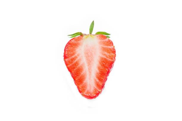 Half of strawberry isolated on white stock photo