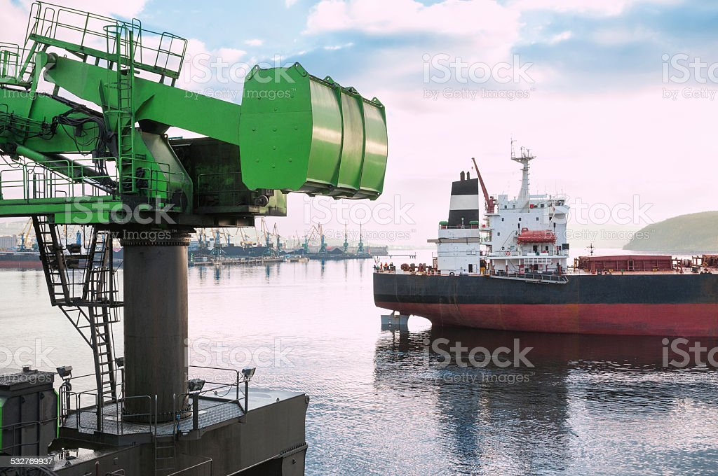 Half of the crane and industrial ship. stock photo