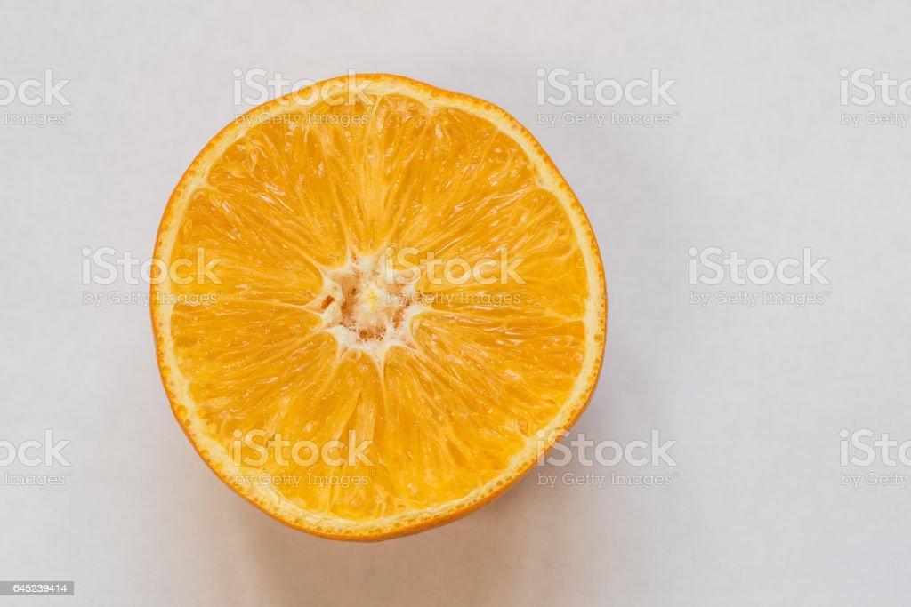 Half orange fruit on white background, fresh and juicy stock photo