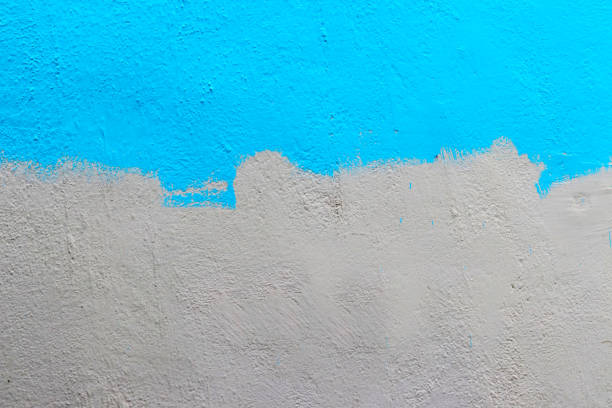 Half Painted Wall - Wallpaper A wall half painted with blue colour. halved stock pictures, royalty-free photos & images