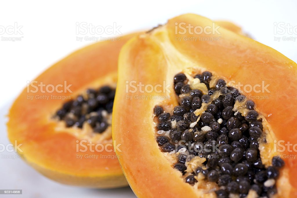 Half papaya on a wooden background royalty-free stock photo