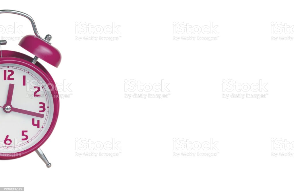 A half past of pink retro alarm clock on white background stock photo