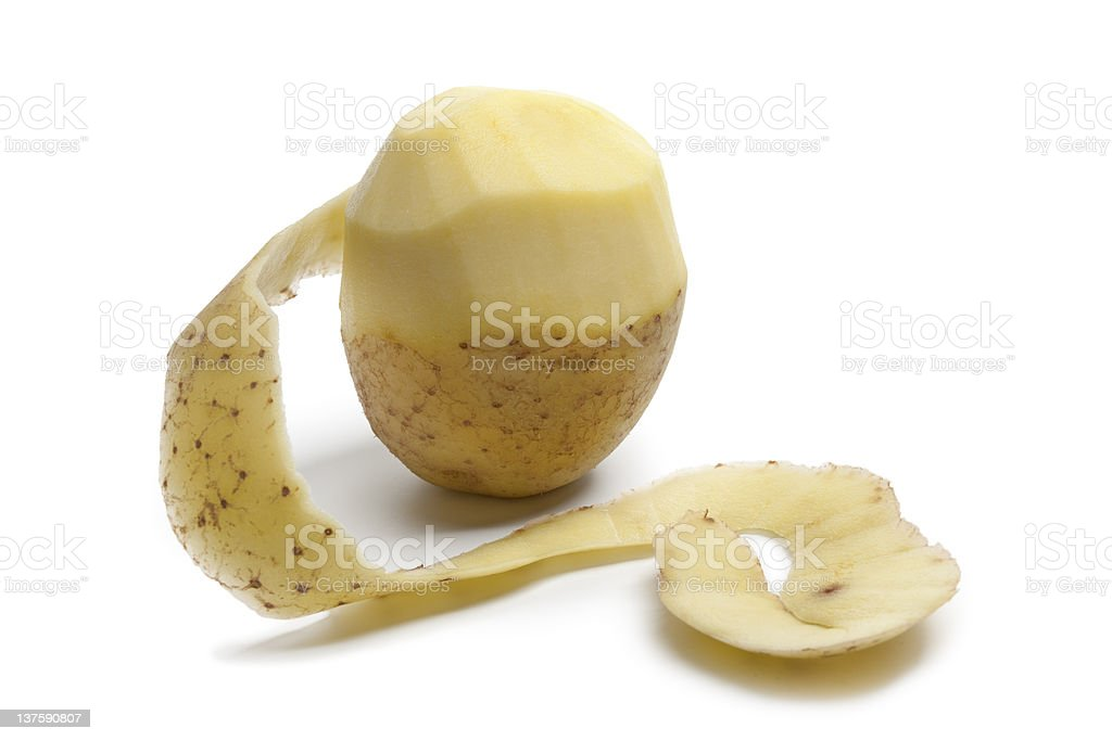 Half peeled fresh potato stock photo