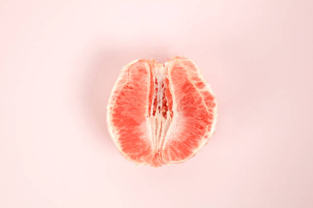half peeled grapefruit stock photo
