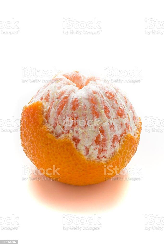 Half peeled orange stock photo