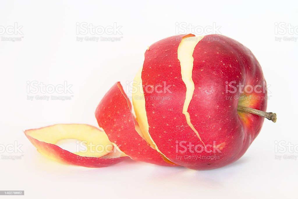 half peeled red apple stock photo