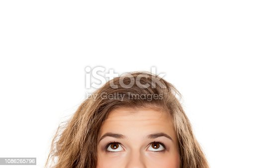 half portrait of a young girl looking up on white background