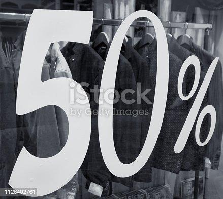 half price discount sale, shop window, clothing store, fashion