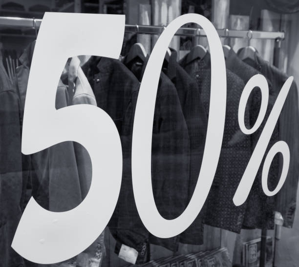 half price discount sale, shop window stock photo