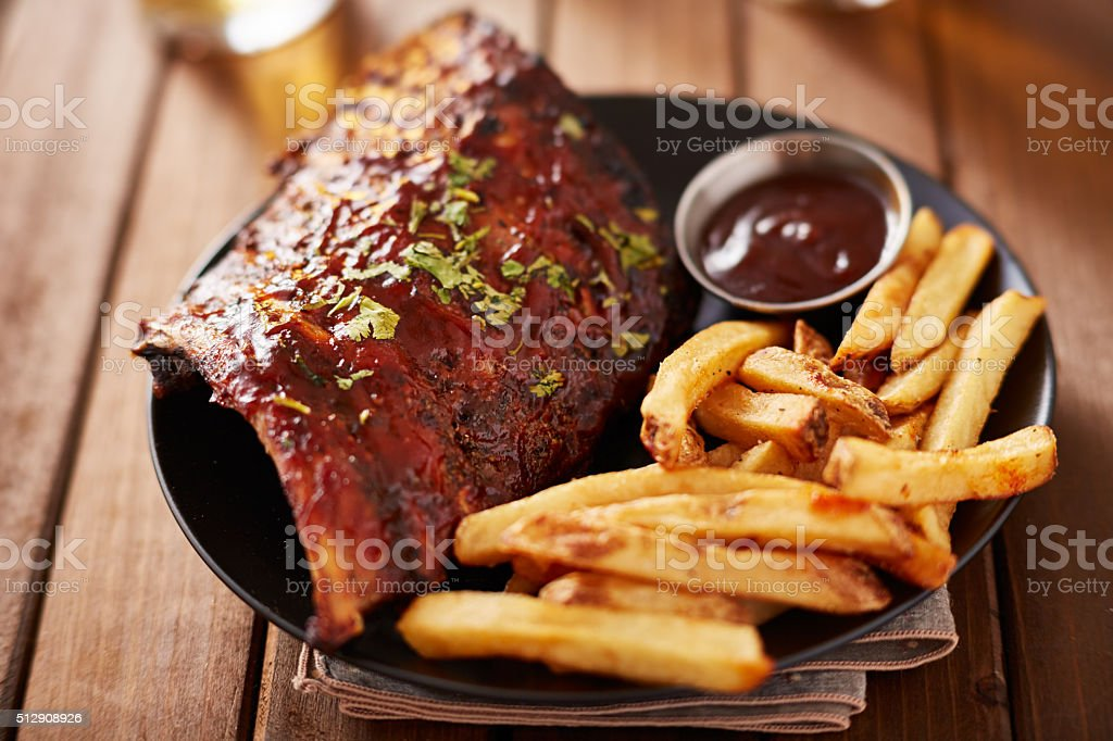 half rack barbecue rib platter with french fries stock photo