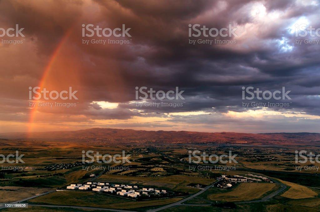 Half Rainbow Rainbow during the rain session Ankara - Turkey Stock Photo