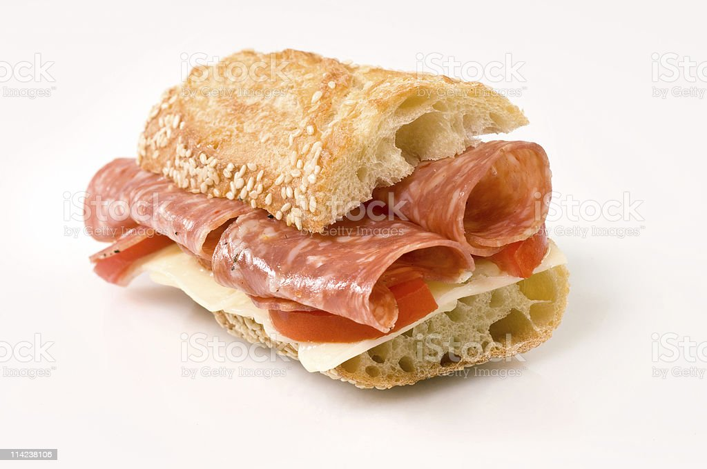 Half Salami and cheese baguette sandwich stock photo