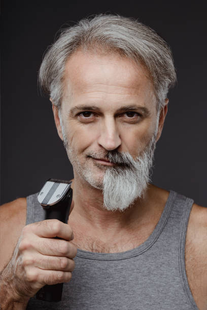 Half shaved beard Man with half shaved beard on his face facial hair stock pictures, royalty-free photos & images