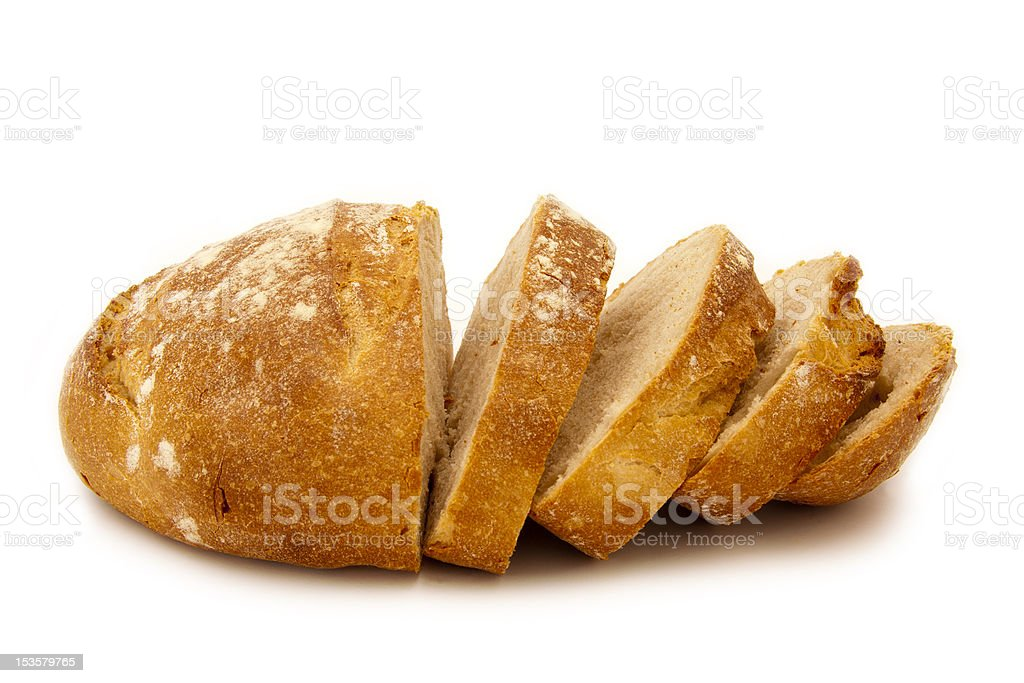 A half sliced loaf of fresh bread stock photo