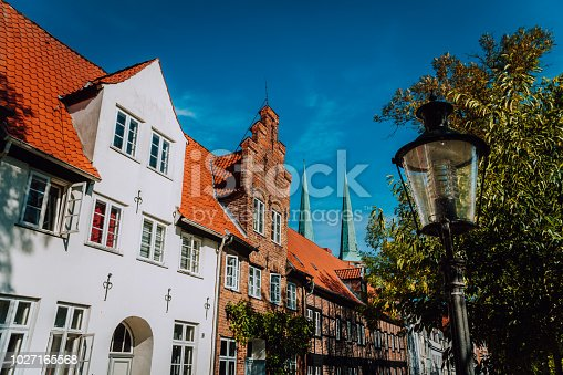 Half timbered and white chalk houses and street lantern in the old center of Luebeck in Schleswig-Holstein, northern Germany.