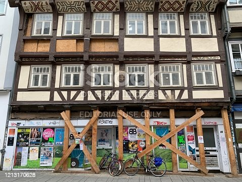 Göttingen, Germany - August, 1 - 2019: Closed half timbered house with event posters, seen in the historic old city.