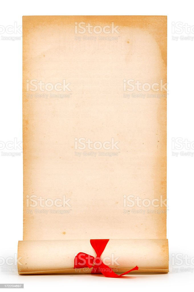Half unrolled paper scroll with a red ribbon around scroll royalty-free stock photo