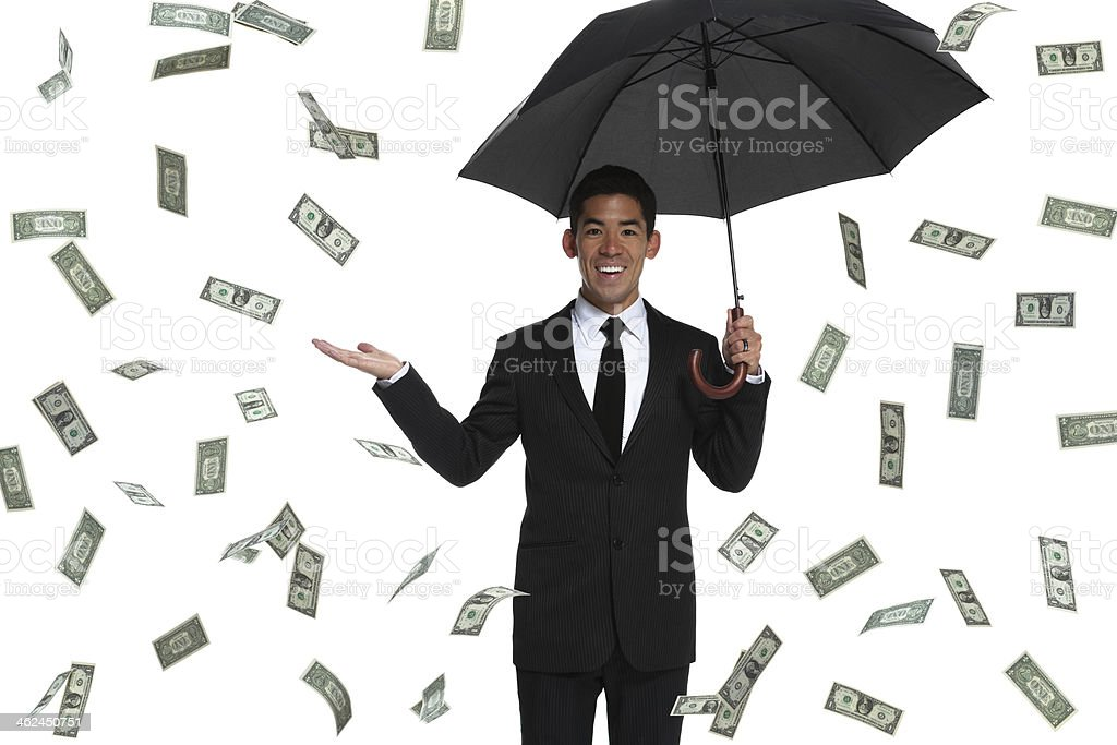 Half-body business man holding an umbrella in raining money with stock photo