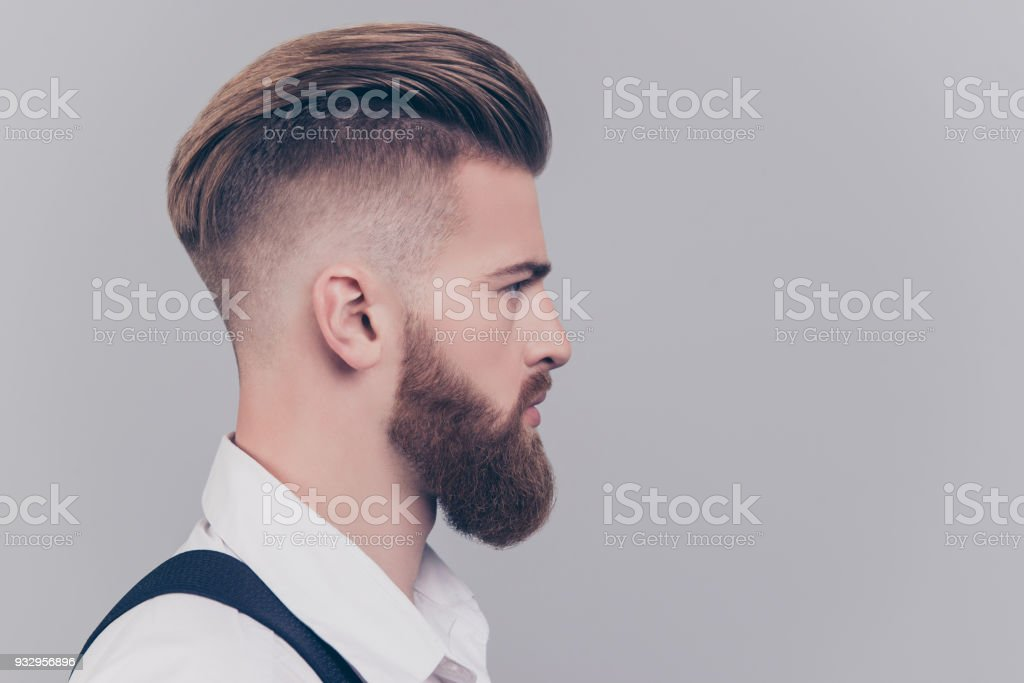 Half-faced portrait of serious concentrated confident brutal chic handsome attractive classy modern guy wearing classic white shirt suspenders isolated on gray background copyspace empty blank - fotografia de stock