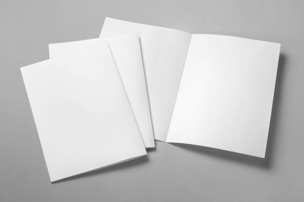 Half-folded booklet, postcard, flyer or brochure Blank half-folded booklet, postcard, flyer or brochure mockup template on gray background catalog stock pictures, royalty-free photos & images