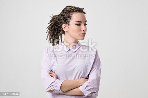 istock Half-length portrait of beautiful woman wearing white blouse looking aside. 847133344