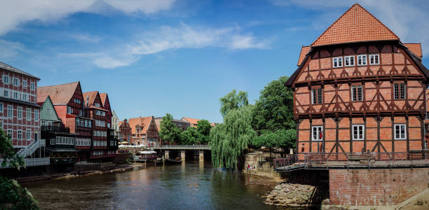 Half-timbered red bricks houses near the river at the old harbor of Luneburg, Germany Half-timbered red bricks houses near the river at the old harbor of Luneburg, Germany. lüneburg stock pictures, royalty-free photos & images