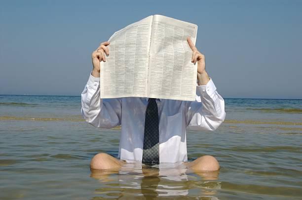 half-vacation - newspaper beach stockfoto's en -beelden