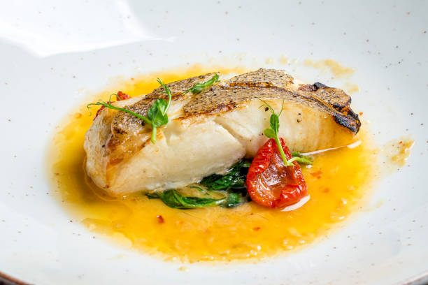 halibut steak on plate halibut steak on plate perch fish stock pictures, royalty-free photos & images