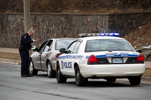 Halifax Police Officer giving motorist a ticket stock photo