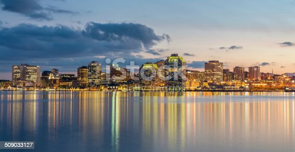 Panoramic Skyline of Halifax City illuminated at night reflecting in the water of Halifax harbour. Halifax, Nova Scotia, Canada.